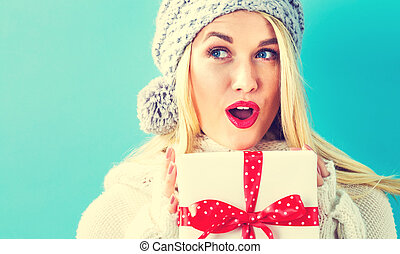 Young woman holding a Christmas gift