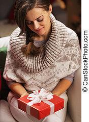 Young woman holding christmas present box