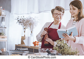Young woman holding cookbook