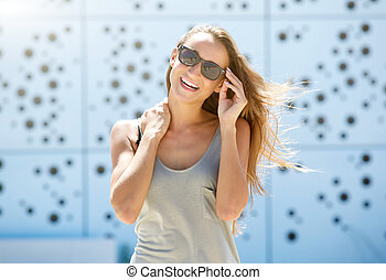 Young woman laughing with sunglasses