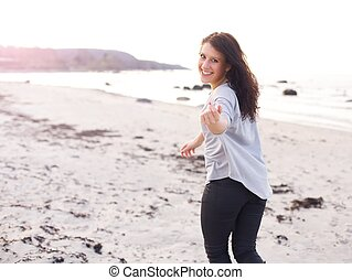 Young Woman Running, Inviting You to Come Closer