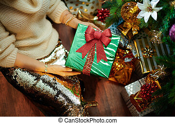 young woman showing Christmas present box