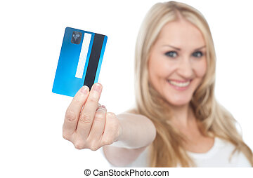 Young woman showing credit card to camera