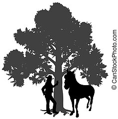 Young woman standing with horse under oak tree