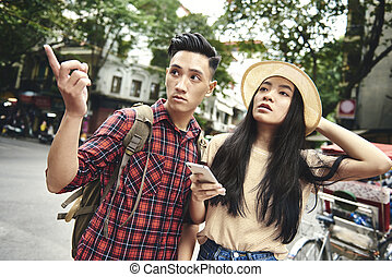 Young woman traveling with boyfriend
