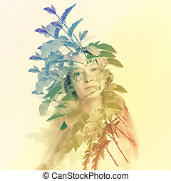 Young woman with abstract leaves