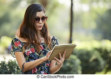 Young woman with digital tablet