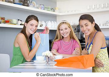 Young women enjoy tea in a cafe