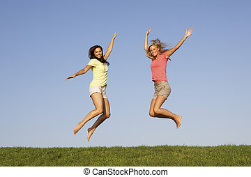Young women jumping in air
